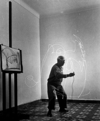 Artist Pablo Picasso using flashlight to make light drawing in the air.  (Photo by Gjon Mili//Time Life Pictures/Getty Images)