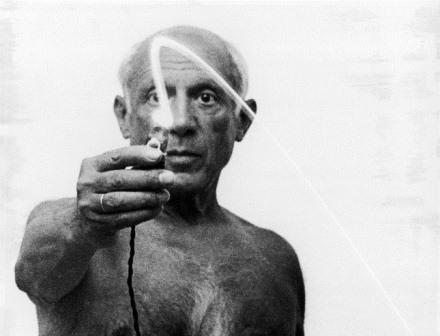 Artist Pablo Picasso using flashlight to begin making light drawing in the air.  (Photo by Gjon Mili//Time Life Pictures/Getty Images)