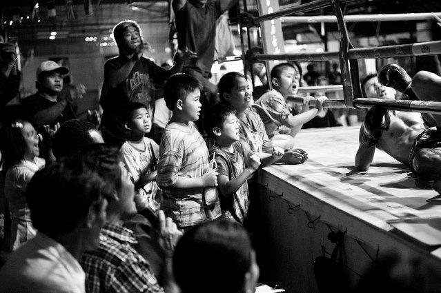 Spectators at a boxing match.